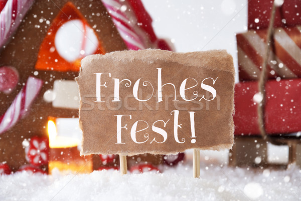 Gingerbread House With Sled, Snowflakes, Frohes Fest Means Merry Christmas Stock photo © Nelosa