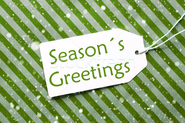 Label On Green Wrapping Paper With Snowflakes, Text Seasons Greetings Stock photo © Nelosa