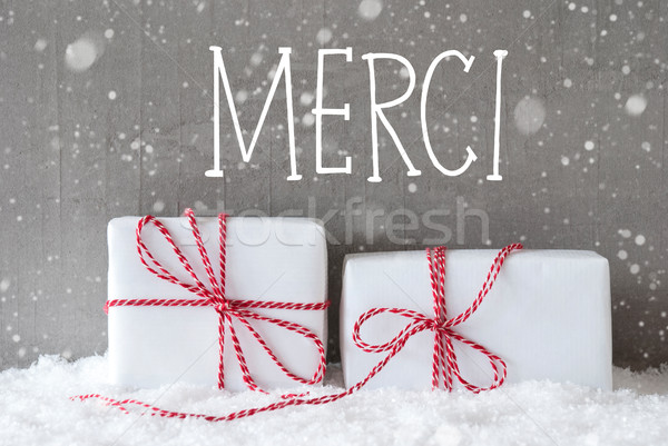 Stock photo: Two Gifts With Snowflakes, Merci Means Thank You