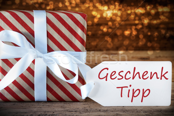 Atmospheric Christmas Present With Label, Geschenk Tipp Means Gift Tip Stock photo © Nelosa