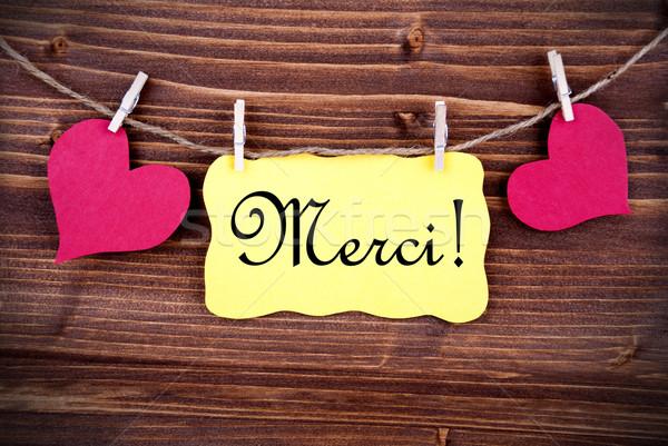 Merci on a Tag Framed By Hearts Stock photo © Nelosa