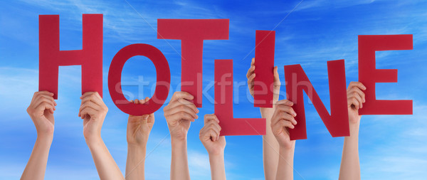 Many People Hands Holding Red Word Hotline Blue Sky Stock photo © Nelosa
