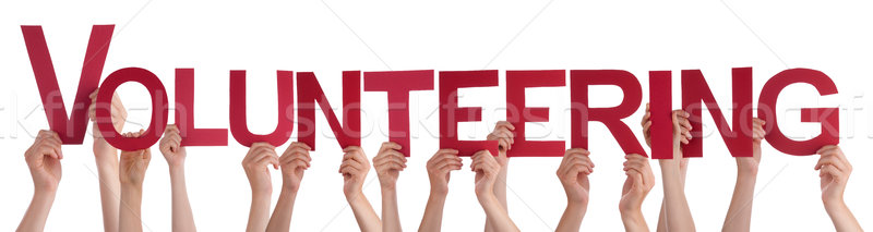 Hands Holding Red Straight Word Volunteering Stock photo © Nelosa