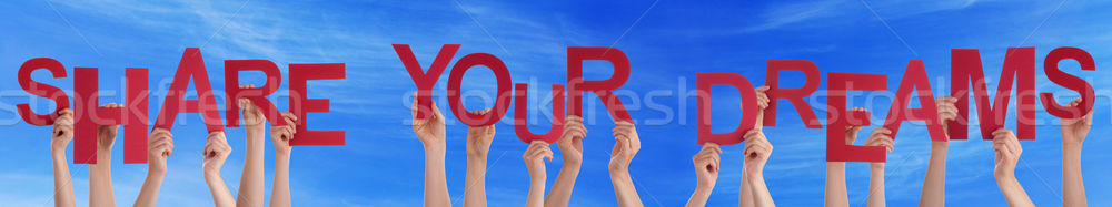 People Hands Holding Red Word Share Your Dreams Blue Sky Stock photo © Nelosa