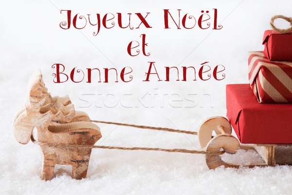 Reindeer With Sled On Snow, Bonne Annee Means New Year Stock photo © Nelosa