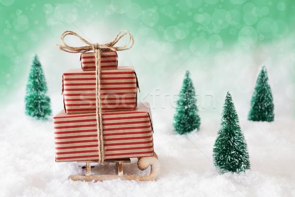 Karácsony hó zöld szánkó ajándékok ajándékok Stock fotó © Nelosa