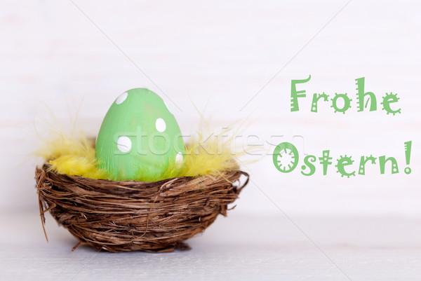 Egy zöld húsvéti tojás fészek kellemes húsvétot húsvéti tojások Stock fotó © Nelosa