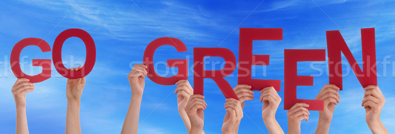 People Hands Holding Red Word Go Green Blue Sky Stock photo © Nelosa