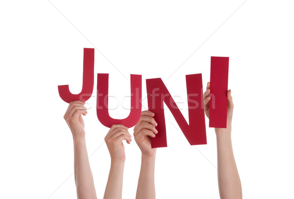 People Holding German Word Juni Means June Stock photo © Nelosa