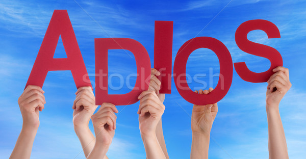 Stock photo: People Hold Spanish Adios Means Goodbye Blue Sky