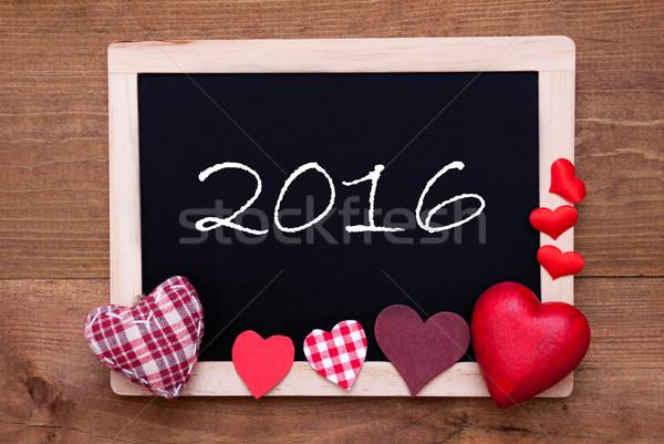 Blackboard With Textile Hearts, Text 2016 Stock photo © Nelosa