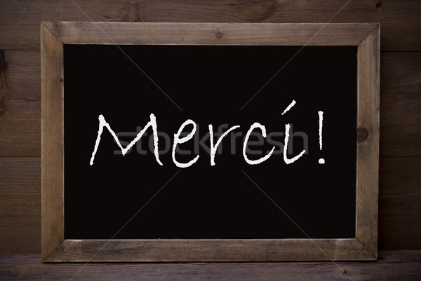 Chalkboard With Merci Means Thank You Stock photo © Nelosa