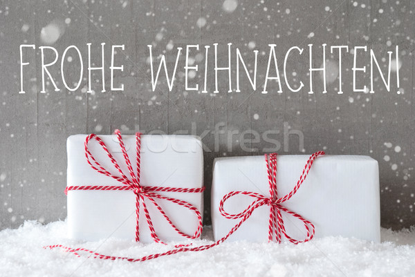 Two Gifts With Snowflakes, Frohe Weihnachten Means Merry Christmas Stock photo © Nelosa