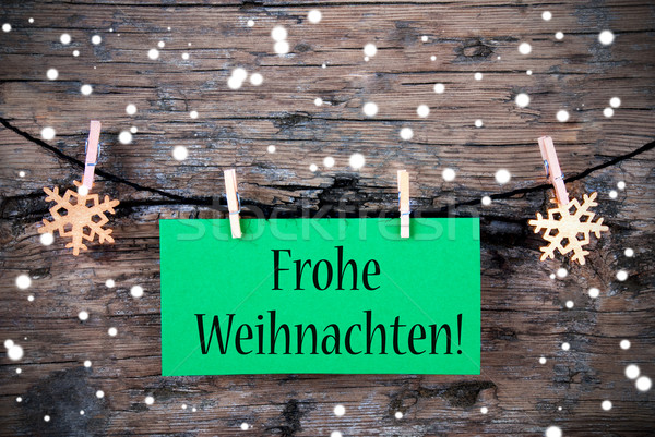 Label with Frohe Weihnachten, Snowy Background Stock photo © Nelosa