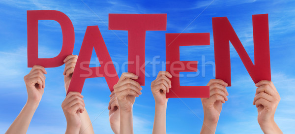 People Holding Red German Word Daten Means Data Blue Sky Stock photo © Nelosa