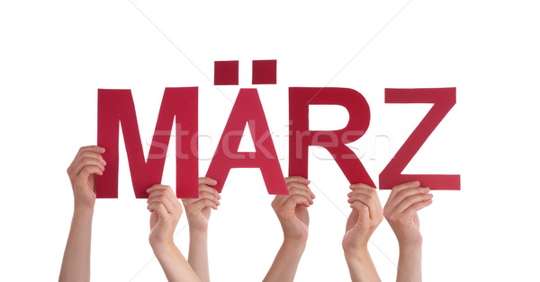 People Holding Straight German Word Maerz Means March  Stock photo © Nelosa
