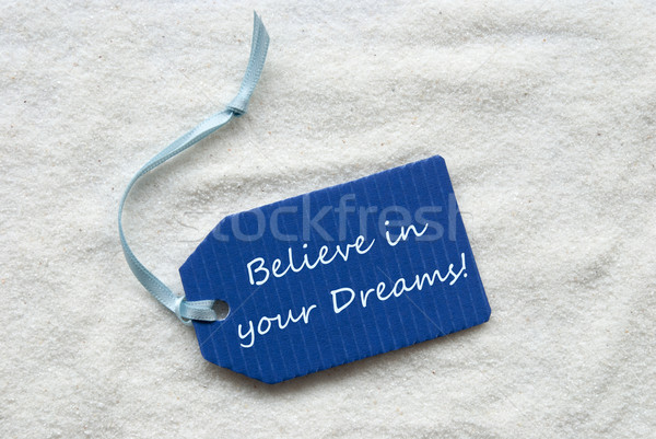 Believe In Your Dreams Blue Label Sand Background Stock photo © Nelosa