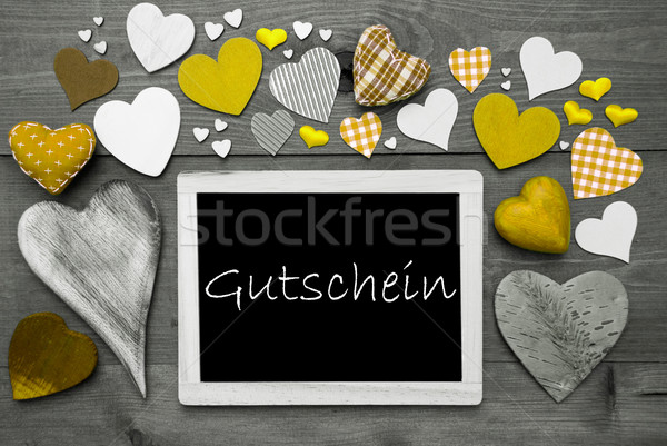 Chalkbord With Many Yellow Hearts, Gutschein Means Voucher Stock photo © Nelosa