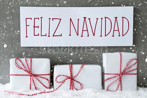 White Gift With Snowflakes, Feliz Navidad Means Merry Christmas Stock photo © Nelosa