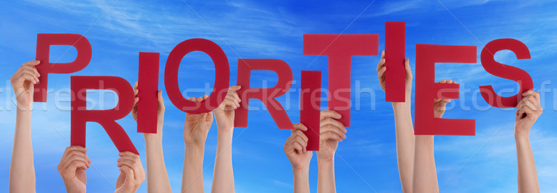People Hands Holding Red Word Priorities Blue Sky Stock photo © Nelosa