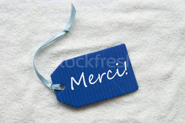 Merci Mean Thank You On Blue Label Sand Background Stock photo © Nelosa