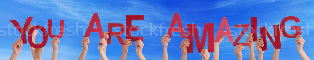People Hands Holding Red Word You Are Amazing Blue Sky Stock photo © Nelosa