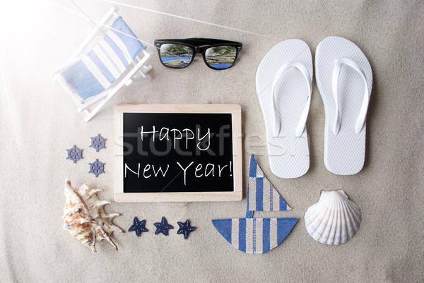 Sunny Blackboard On Sand With Text Happy New Year Stock photo © Nelosa