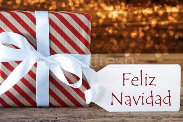 Atmospheric Gift With Label, Feliz Navidad Means Merry Christmas Stock photo © Nelosa