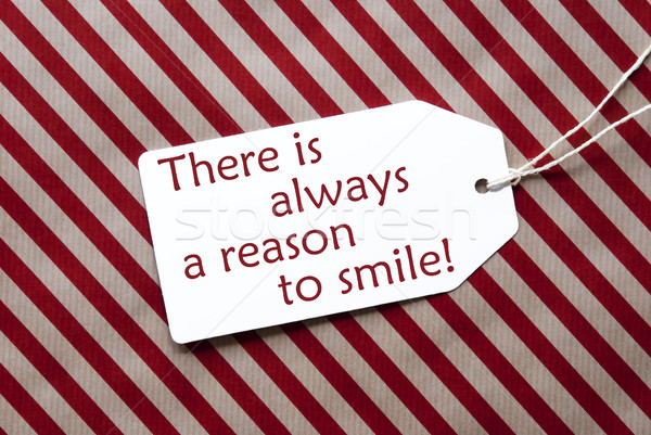 Label On Red Wrapping Paper, Quote Always Reason To Smile Stock photo © Nelosa