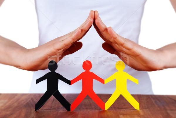 Kezek színes papír lánc emberek kéz Stock fotó © Nelosa