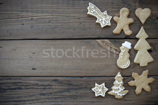 Decorated Ginger Bread Cookies on Wooden Plank Stock photo © Nelosa