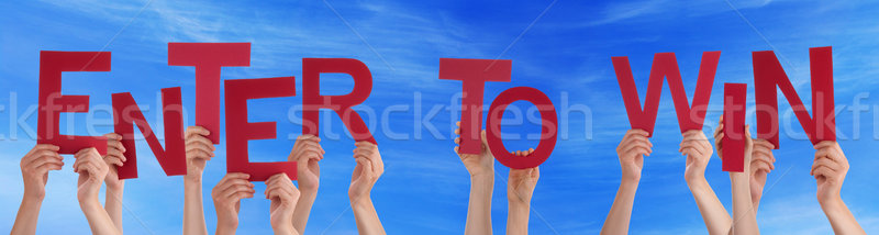 People Hands Holding Red Word Enter To Win Blue Sky Stock photo © Nelosa