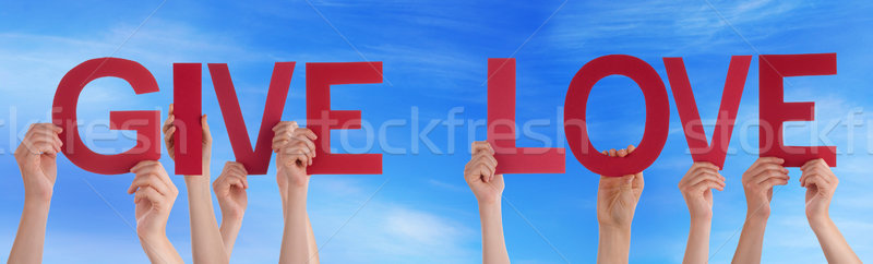 People Hands Holding Red Straight Word Give Love Blue Sky Stock photo © Nelosa