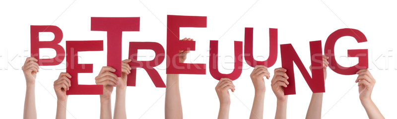 People Holding German Word Betreuung Means Care Stock photo © Nelosa
