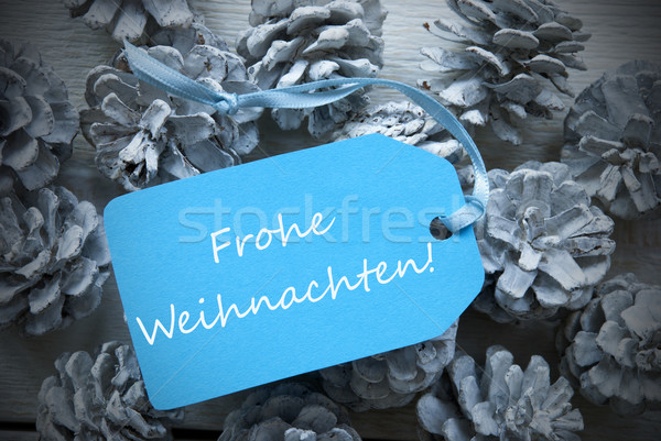Label On Fir Cones Frohe Weihnachten Means Merry Christmas Stock photo © Nelosa