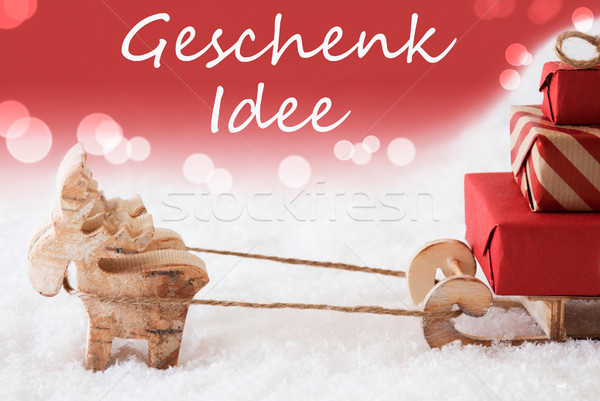 Reindeer With Sled, Red Background, Geschenk Idee Means Gift Idea Stock photo © Nelosa