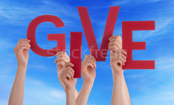 Many People Hands Holding Red Word Give Blue Sky Stock photo © Nelosa