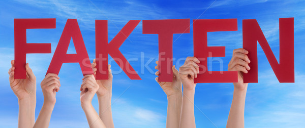 People Holding Straight German Word Fakten Means Fact Blue Sky Stock photo © Nelosa