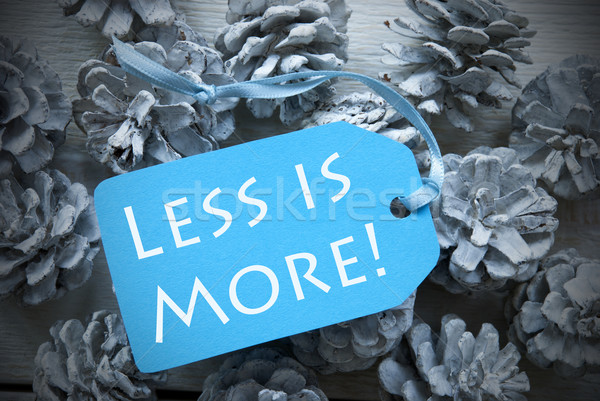 Light Blue Label On Fir Cones Quote Less Is More Stock photo © Nelosa