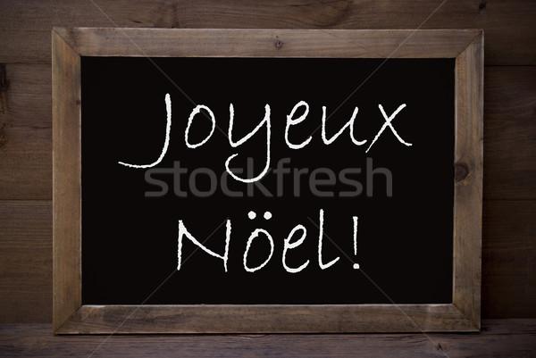 Chalkboard With Joyeux Noel Means Merry Christmas Stock photo © Nelosa