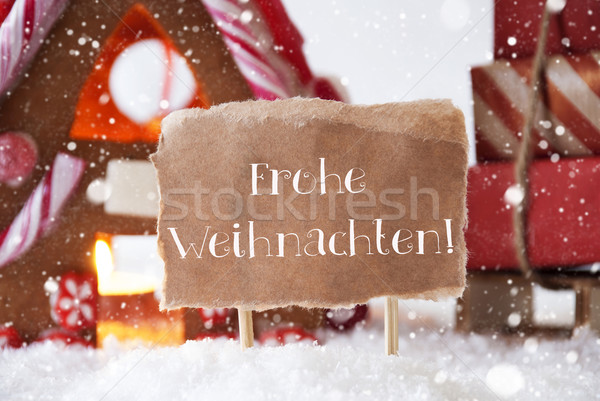 Gingerbread House With Sled, Snowflakes, Frohe Weihnachten Means Merry Christmas Stock photo © Nelosa