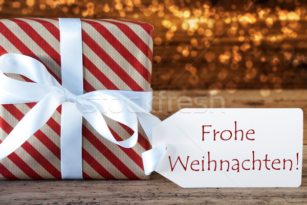 Atmospheric Gift With Label, Frohe Weihnachten Means Merry Chris Stock photo © Nelosa