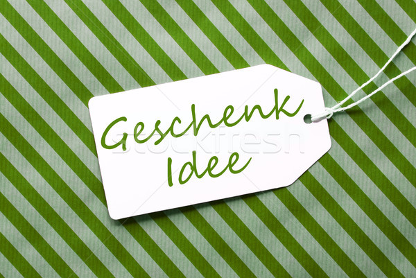 Label On Green Wrapping Paper, Geschenk Idee Means Gift Idea Stock photo © Nelosa