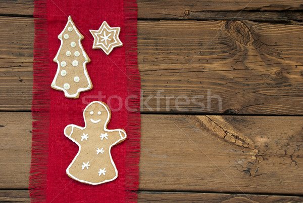 Ginger Bread on Red and Wooden Background Stock photo © Nelosa