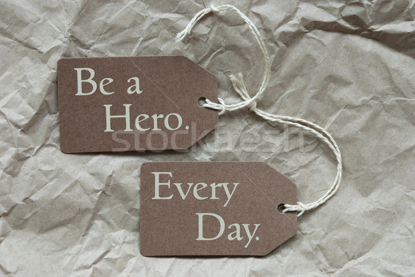 Two Brown Labels With Quote Hero Every Day Paper Background Stock photo © Nelosa