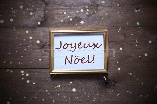 Picture Frame With Joyeux Noel Means Merry Christmas, Snowflakes Stock photo © Nelosa