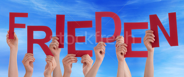 People Holding German Word Frieden Means Peace Blue Sky Stock photo © Nelosa