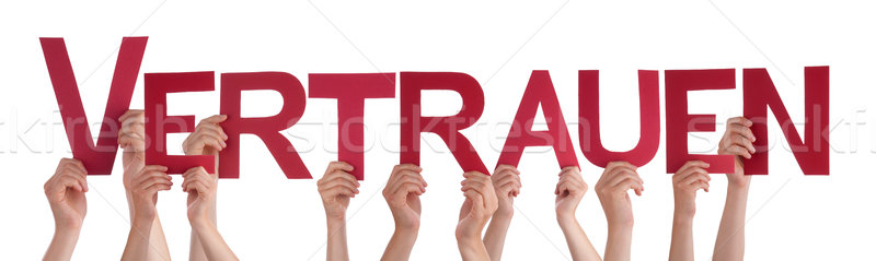 People Holding Straight Word Vertrauen Means Trust Stock photo © Nelosa