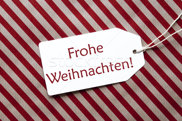 Label On Red Wrapping Paper, Frohe Weihnachten Means Merry Christmas Stock photo © Nelosa