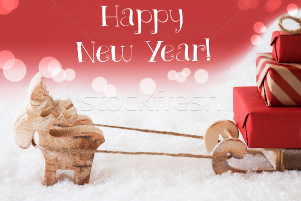 Reindeer With Sled, Red Background, Text Happy New Year Stock photo © Nelosa